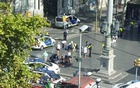 Police and emergency services attend to injured persons at the scene after a van crashed into pedestrians near the Las Ramblas avenue in central Barcelona, Spain August 17, 2017, in this still image from a video obtained from social media. Courtesy of @Vil_Music/via REUTERS