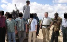Paul Hopkins and hired gunmen protecting BAT management and local staff in Mogadishu, Somalia. Photograph: Paul Hopkins via The Guardian.