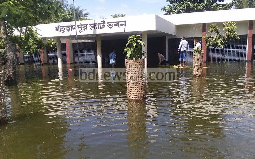 A raft made of Banana trees and bamboos is being used to reach the court house in flood-affected Shahajadpur Upazila in Sirajganj. The picture is taken on Sunday.