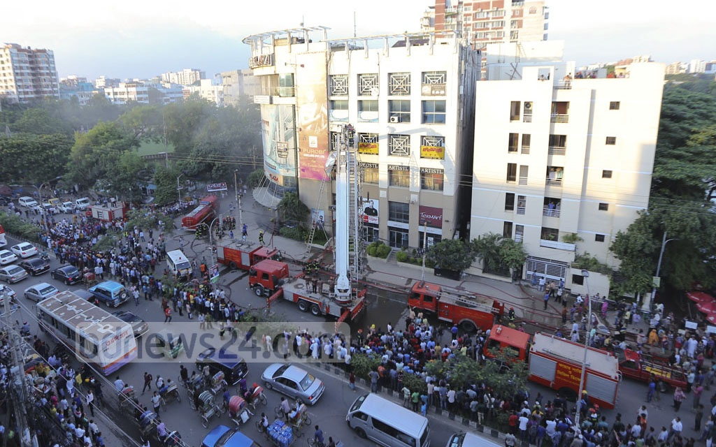 Firefighters try to douse a fire at Anam Rangs Plaza, a multi-storey mall at Dhaka's Dhanmondi, on Sunday.