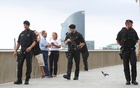 Armed Catalan Mossos d'Esquadra officers patrol along La Barceloneta beach in Barcelona, Spain, Aug 19, 2017. Reuters