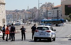 French police block the street after one person was killed and another injured after a vehicle crashed into two bus shelters, in Marseille, France, August 21, 2017. Reuters