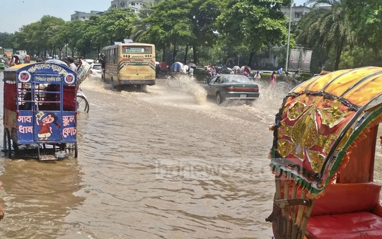 The submerged road in front of the National Parliament at Dhaka's Manik Mia Avenue after rains on Tuesday morning.