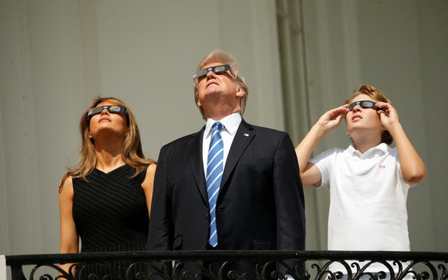 US President Donald Trump watches the solar eclipse with first Lady Melania Trump and son Barron from the Truman Balcony at the White House in Washington, US, August 21, 2017. Reuters