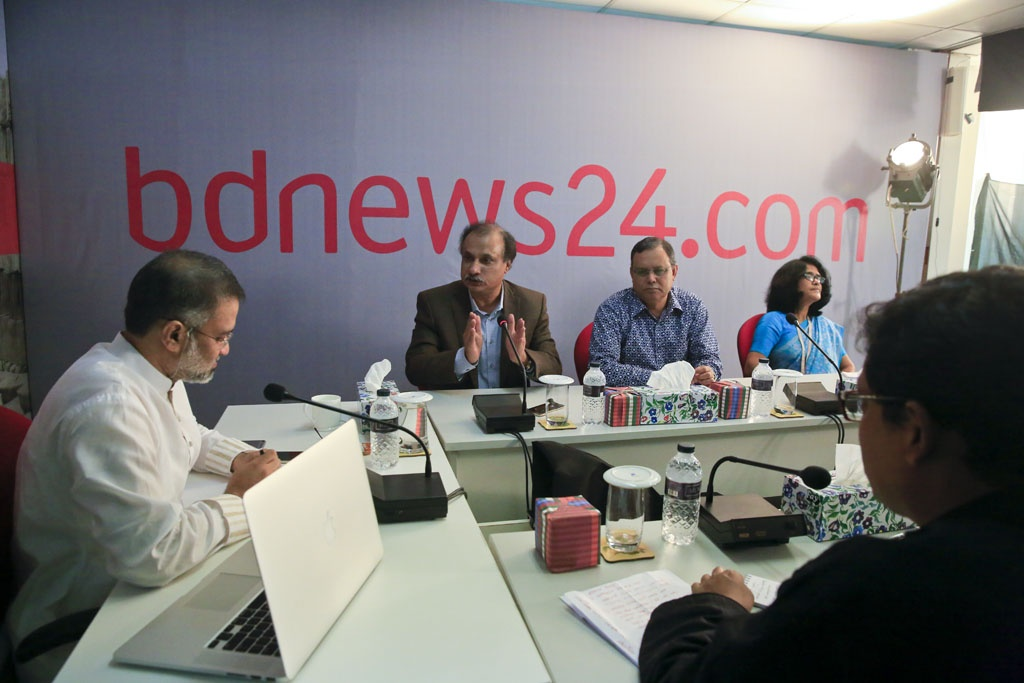 Ekattor TV chief editor Mozammel Haque Babu takes part in the discussion on 'Children in Media' at the offices of bdnews24.com on Thursday.
