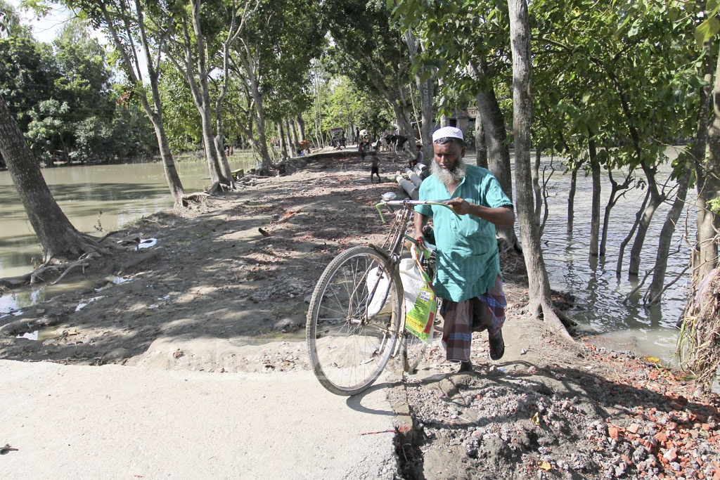 Many roads in the area have been damaged by the floodwaters, as seen on Wednesday in Baliadaha village of Islampur in Jamalpur. Photo: asif mahmud ove