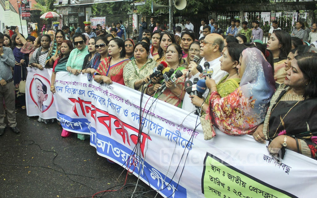 Food Minister Qamrul Islam speaks during a Mohila Awami League demonstration for demanding the resignation of Chief Justice SK Sinha over a verdict cancelling the 16th amendment. Photo taken at the National Press Club on Friday. Photo: abdul mannan