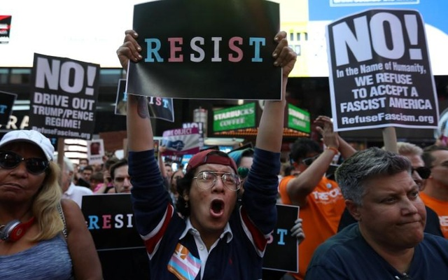 People protest US President Donald Trump's announcement that he plans to reinstate a ban on transgender individuals from serving in any capacity in the US military, in Times Square, in New York City, New York, US. Reuters