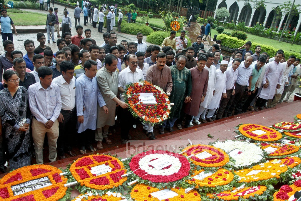 Several social and cultural organisations place floral wreaths at the grave of National Poet Kazi Nazrul Islam marking his 41st death anniversary on Sunday. Photo: tanvir ahammed