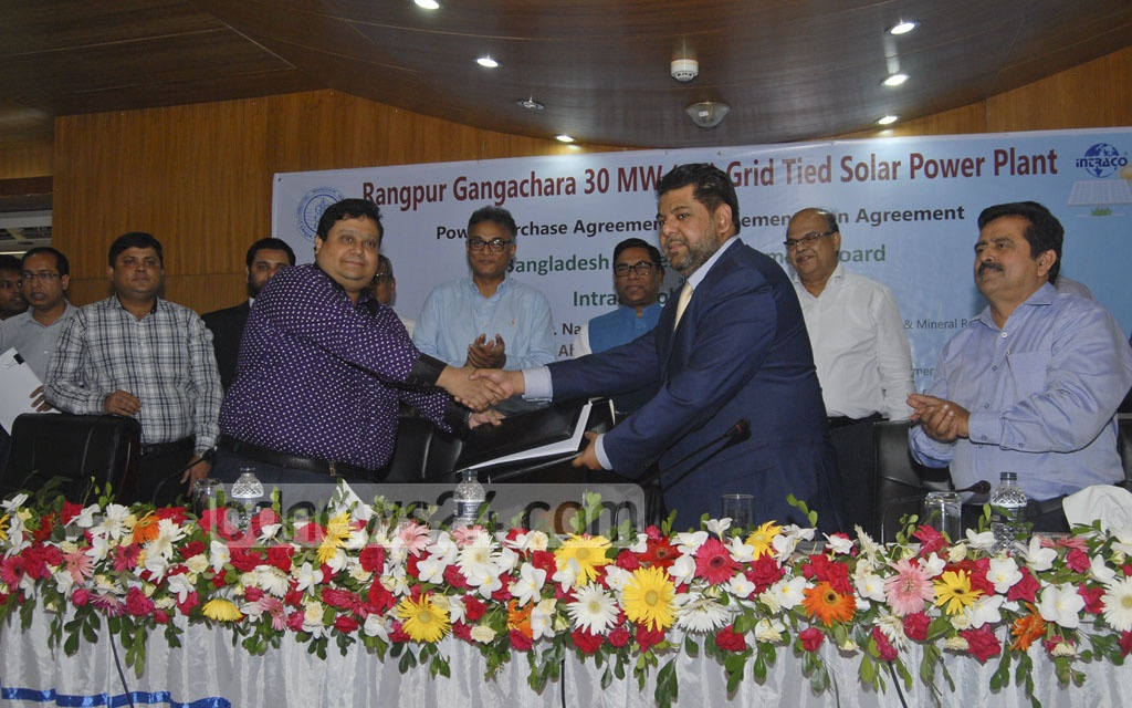 Representatives from Intraco Solar Power Ltd and Power Development Board at a ceremony to sign agreements on project execution and purchase and selling of electricity in Dhaka on Sunday. Photo: asif mahmud ove