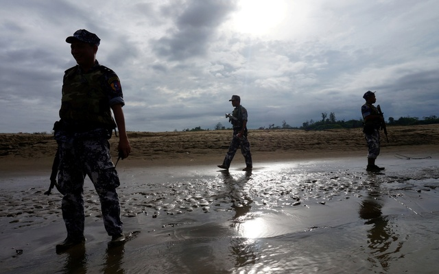 File Photo: A Myanmar border guard police officers stand guard in Buthidaung, northern Rakhine state, Myanmar Jul 13, 2017. Reuters
