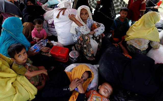 Rohingya people sit on a makeshift shelter near the Bangladesh-Myanmar border as they are being restricted by the Members of Border Guard Bangladesh (BGB), in Cox's Bazar, Bangladesh, August 27, 2017. Reuters