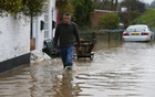 Undated Reuters file photo shows flooded streets in Tewkesbury, Gloucestershire.