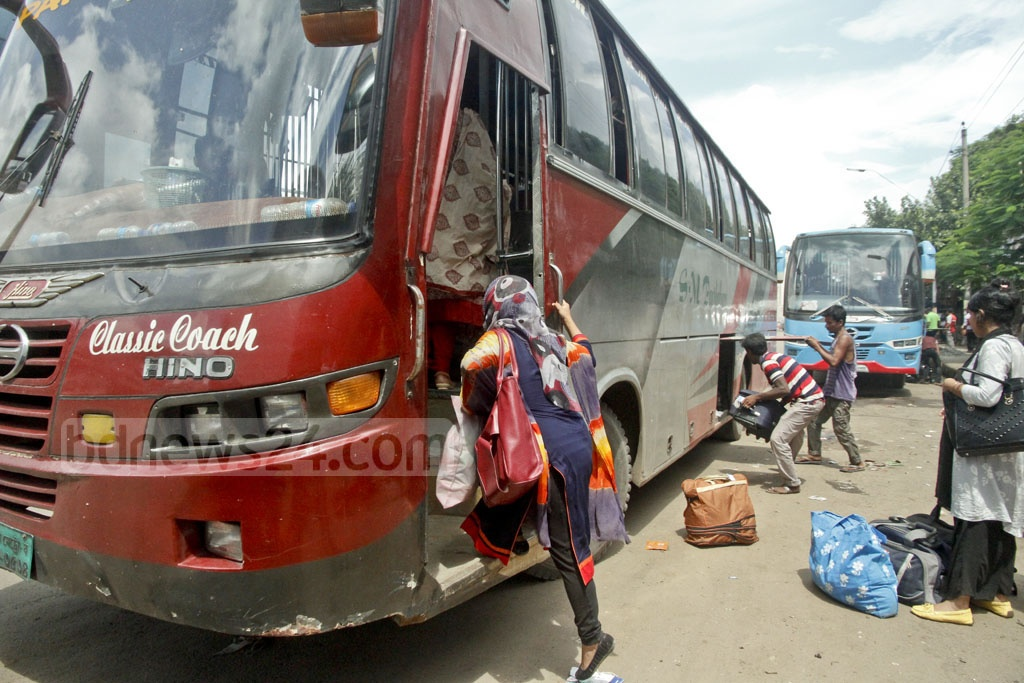 A family board a bus at Gabtoli Bus Station on Tuesday, just few days before Eid-ul-Azha is celebrated.