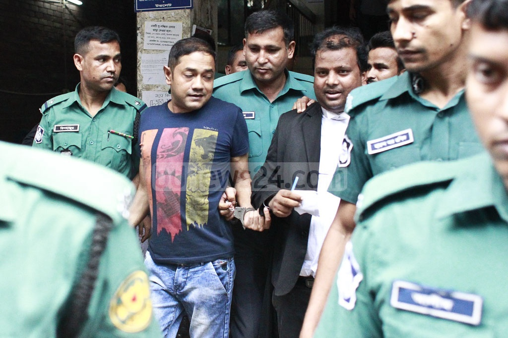 Sohel Rana, the owner of the infamous Rana Plaza that collapsed killing more than a thousand factory workers, is being escorted out of a Dhaka courtroom on Tuesday after being sentenced in one of the cases against him.