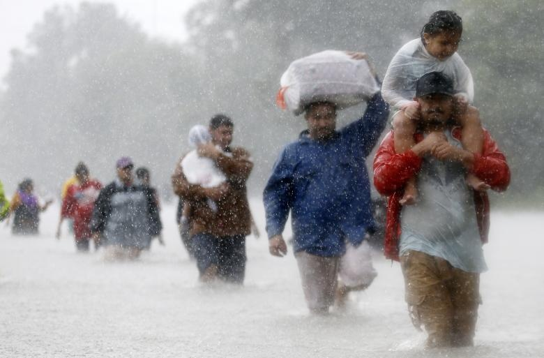 Residents wade through flood waters from Tropical Storm Harvey in Beaumont Place, Houston, Texas. Reuters
