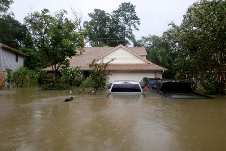 Houses and cars are seen partially submerged by flood waters in east Houston, Texas. Reuters
