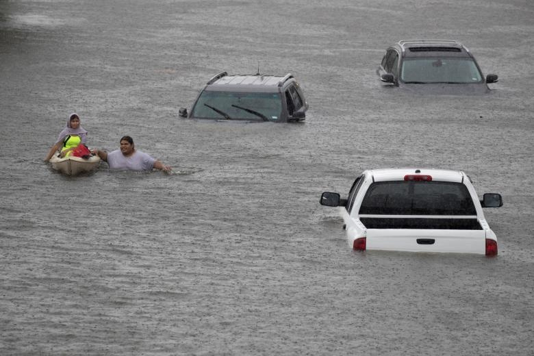 Jesus Rodriguez rescues Gloria Garcia in Pearland, in the outskirts of Houston. Reuters