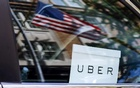 An Uber sign is seen in a car in New York, US. June 30, 2015. Reuters