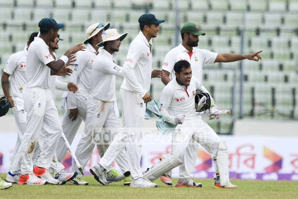 Tigers celebrate their first-ever victory over the Aussies in Test at Dhaka's Sher-e-Bangla National Cricket Stadium on Wednesday. Photo: mostafigur rahman