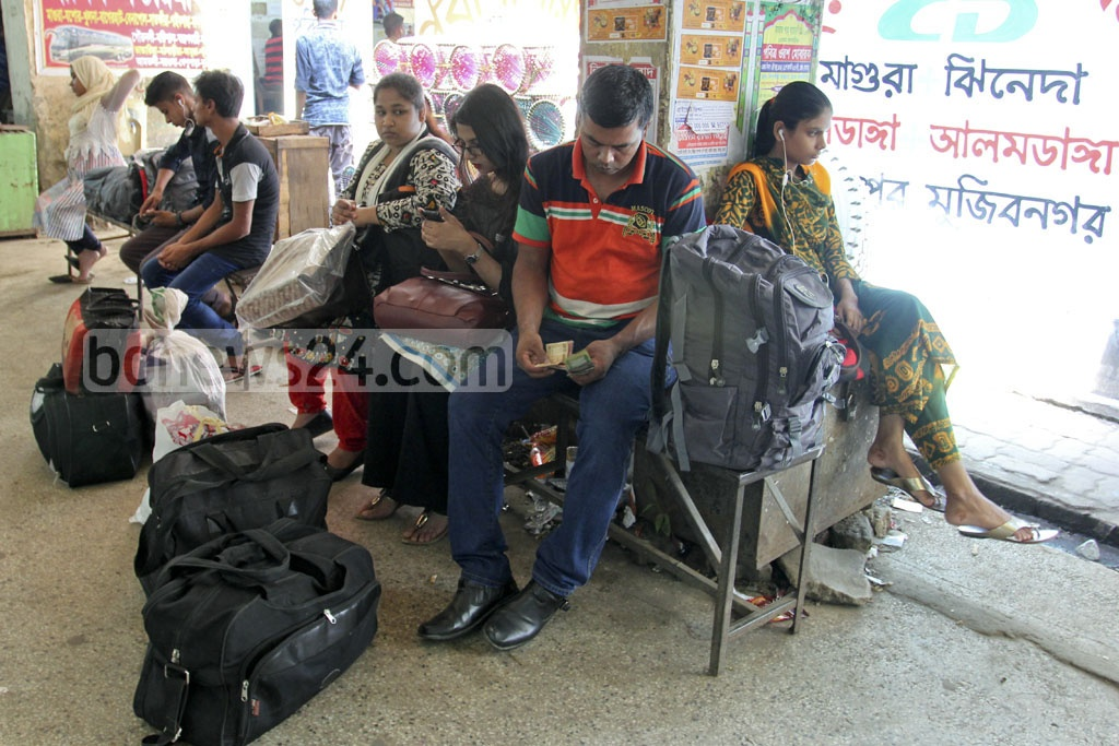 Families wait at Dhaka's Gabtoli Bus Terminal on Wednesday to head to their hometowns to celebrate Eid-Ul-Azha, which is now just two days away, with near ones. Photo: asif mahmud ove