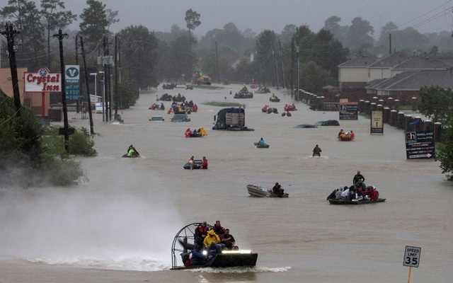 Residents use boats to evacuate flood waters from Tropical Storm Harvey along Tidwell Road east Houston Texas US Aug 28 2017. Reuters