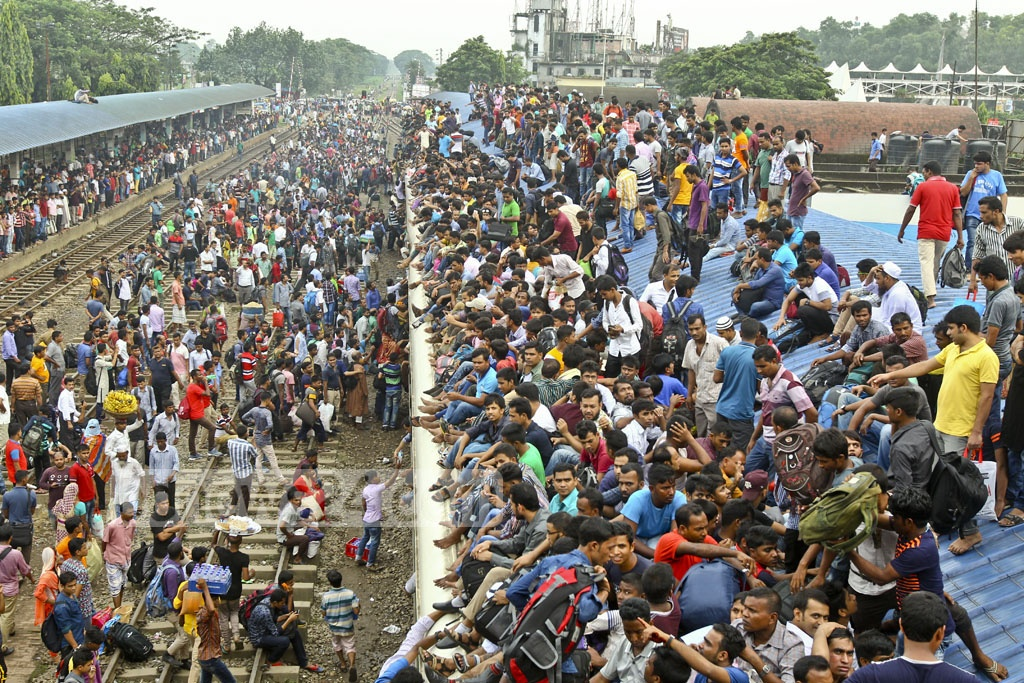 The roof of trains is the only hope for some of those who fail to manage any space inside the packed compartments to celebrate the Eid with their families. Photo: tanvir ahammed