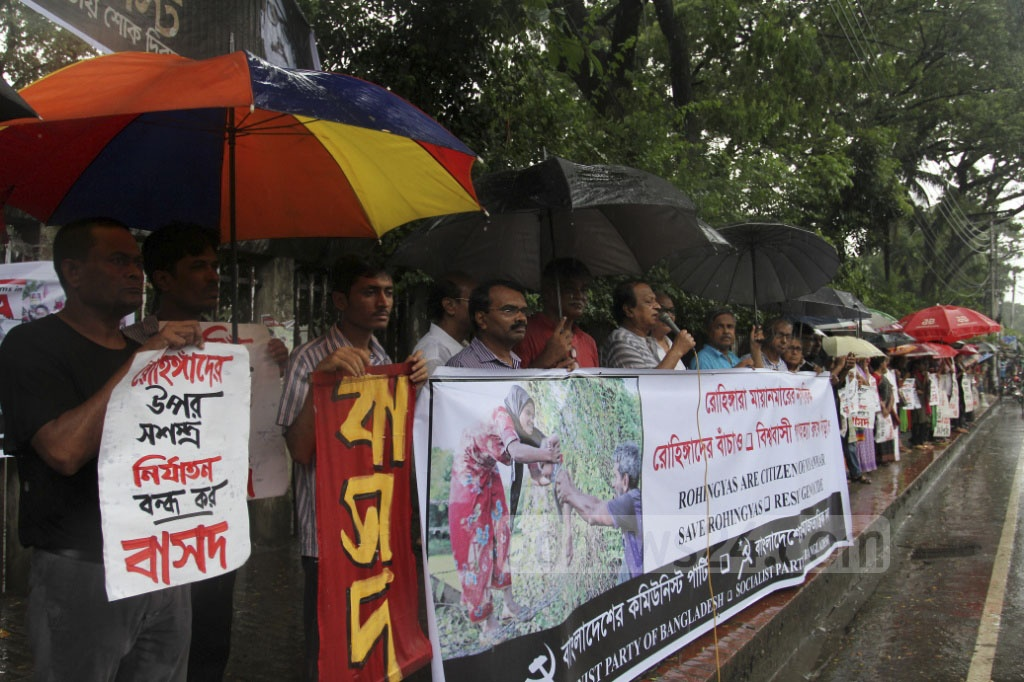 Communist Party of Bangladesh and Socialist Party of Bangladesh demonstrate in front of the National Press Club in Dhaka on Thursday demanding an end to violence against Rohingyas in Myanmar. Photo: asif mahmud ove