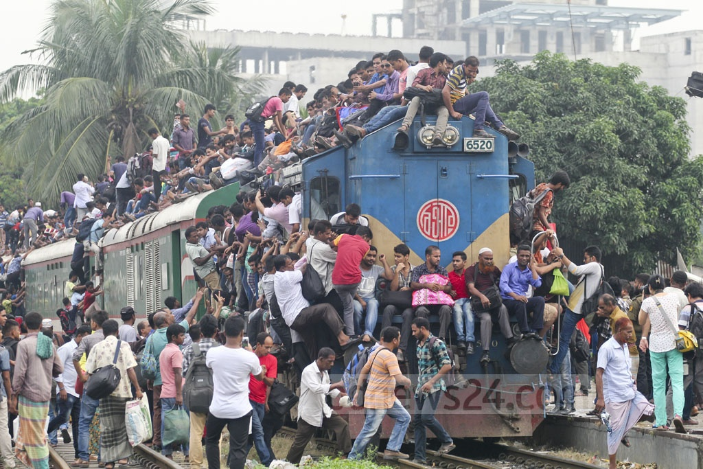 The roof of trains is the only hope for some of those who fail to manage any space inside the packed compartments to celebrate the Eid with their families. Photo: asif mahmud ove