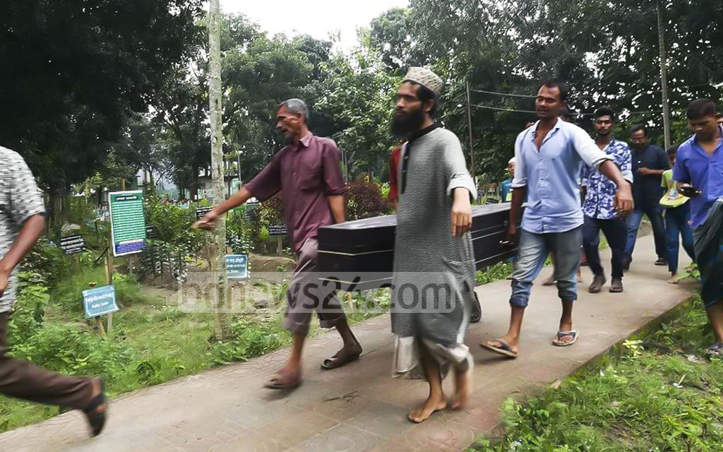 The coffin carries remains of Zakia Sultana Rupa who had allegedly been gang-raped and murdered on a moving bus. With court's permission, the remains were exhumed in Tangail in the presence of an executive magistrate on Thursday.