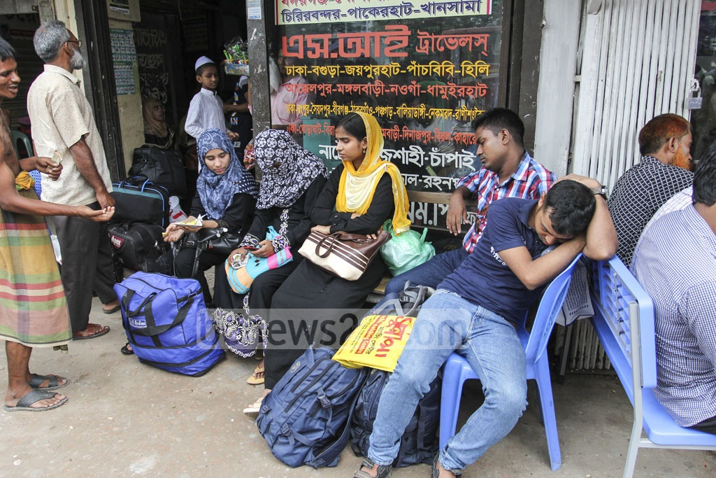 Homebound Eid holidaymakers wait for transport at Gabtoli Bus Terminal on Friday. Photo: asif mahmud ove