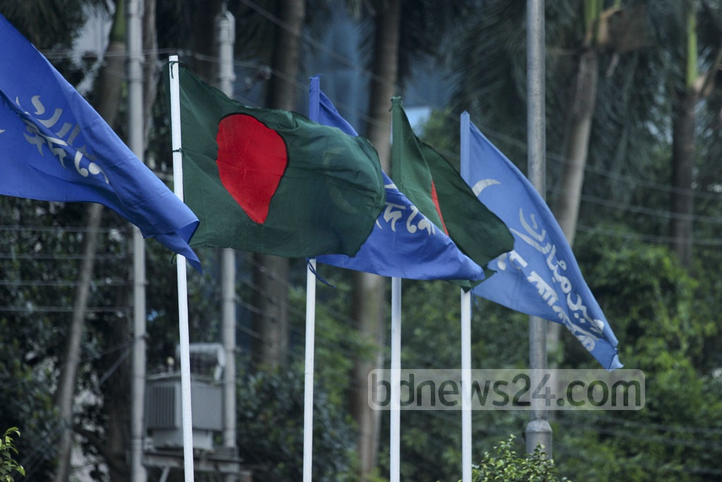 National flags fly next to flags with 'Eid Mubarak' written on them on the streets of Dhaka before Eid-ul-Azha. Photo: abdul mannan