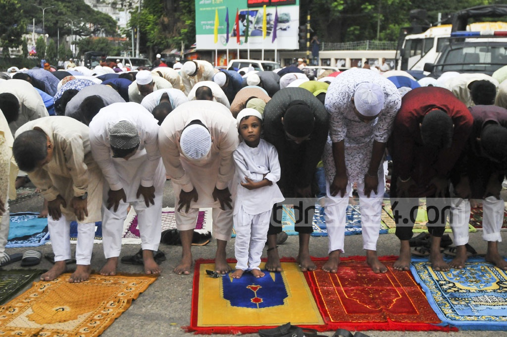 A child takes part in Dhaka's main Eid-ul-Azha congregation at National Eidgah Ground on Saturday.