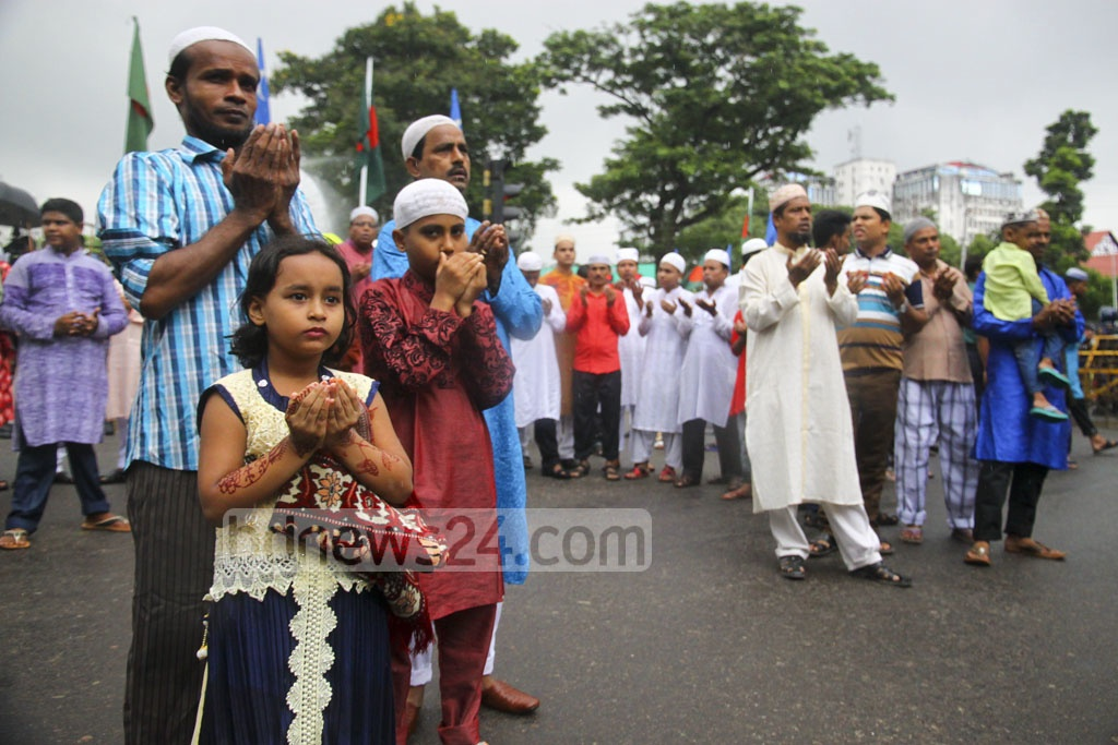 Children pray along with elders after Dhaka's main Eid-ul-Azha congregation at National Eidgah Ground on Saturday.