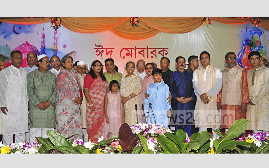 Prime Minister Sheikh Hasina, members of her family and some Awami League leaders pose for a group photo while exchanging greetings with people from all walks of life at the Ganabhaban on Eid-ul-Azha on Saturday.