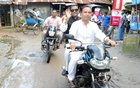 Photos of Minister Quader without helmet on motorbike draw flak on social media