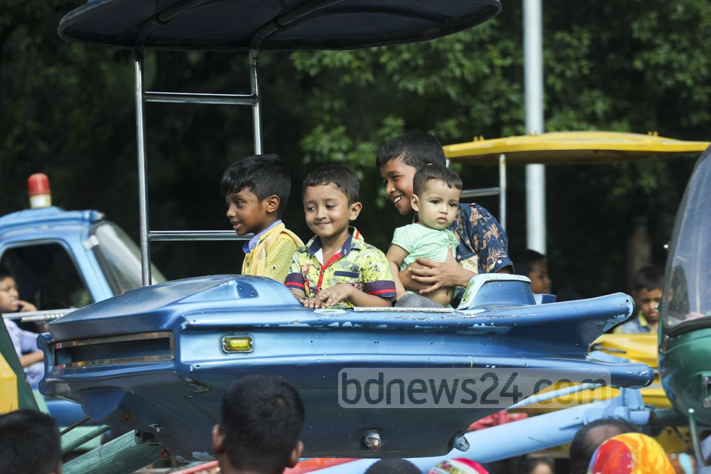Children enjoy a ride at Dhaka Shishu Park a day after the Eid on Sunday. Photo: abdul mannan