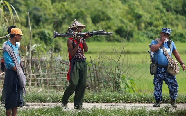 A Myanmar soldier (C) and a policeman patrol a road in Maungdaw, Myanmar August 31, 2017. Reuters