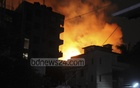 Several explosions trigger a fire at a suspected terror hideout on Mazar Road, lighting up the area at Dhaka's Mirpur. Photo: asif mahmud ove