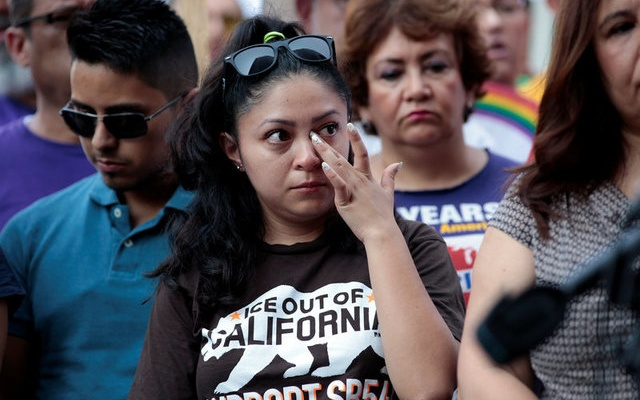 Diana, a Deferred Action for Childhood Arrivals (DACA) program recipient wipes away a tear listening to the parent of a DACA recipient speak during a rally outside the Federal Building in Los Angeles, California, US, September 1, 2017. Reuters