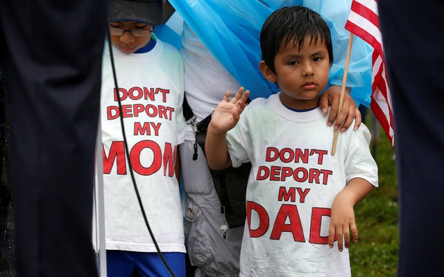 Boys wearing shirts calling for their parents not to be deported stand during a rally by immigration activists CASA and United We Dream demanding the Trump administration protect the Deferred Action for Childhood Arrivals (DACA) program and the Temporary Protection Status (TPS) programs, in Washington, US, August 15, 2017. Reuters