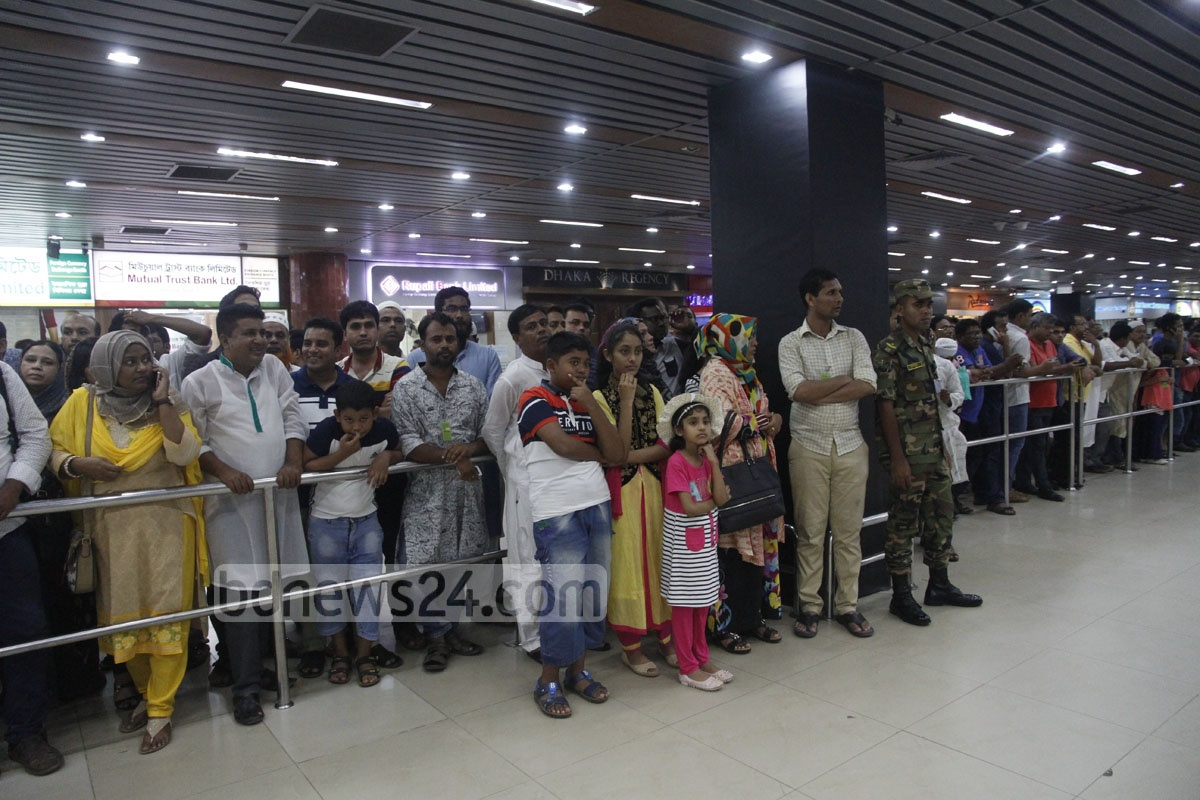 People wait for their relatives to come through Dhaka's Shahjalal International Airport on Wednesday night after performing hajj in Saudi Arabia. Photo: tanvir ahammed