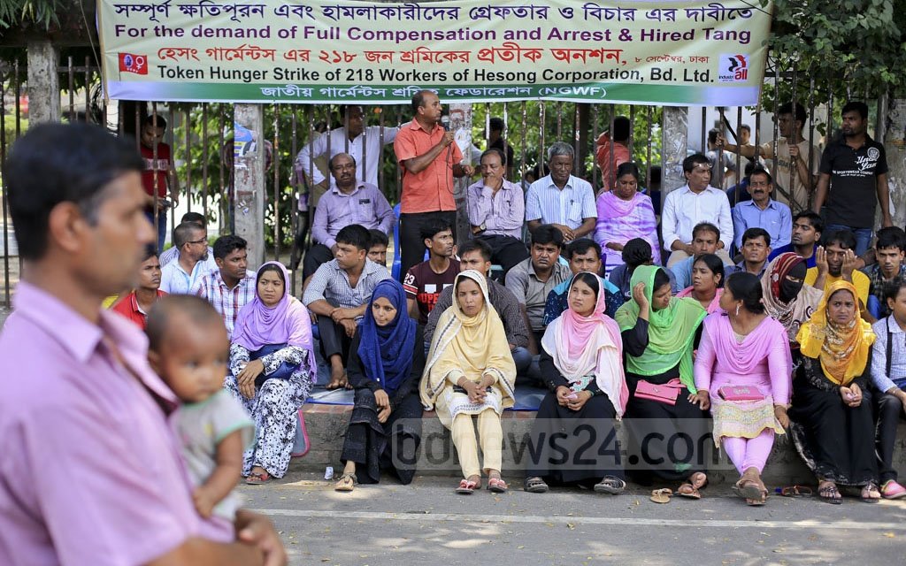 Laid-off workers of Korean-owned Haesong Corporation's garment factory stage protests outside Dhaka's National Press Club on Friday. Photo: asaduzzaman pramanik