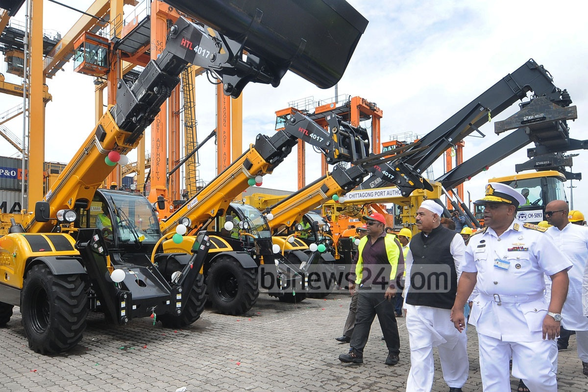 Shipping Minister Shajahan Khan inspects recently bought equipment for handling cargo and containers in Chittagong on Friday. Photo: suman babu