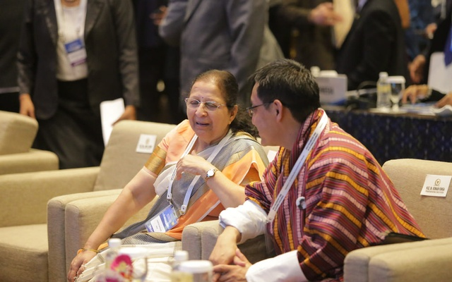 India Lok Sabha Speaker Sumitra Mahajan interacts with another guest at the World Parliamentary Forum on Sustainable Development in Indonesia.