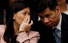 FILE PHOTO: Maia Santos Deguito, a branch manager of the Rizal Commercial Banking Corp (RCBC) whispers to her lawyer as she testifies during a Senate hearing on the money laundering involving $81 million stolen from Bangladesh central bank, at the Philippine Senate in Manila April 12, 2016. Reuters
