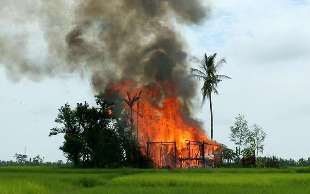 A house is seen on fire in Gawduthar village, Maungdaw township, in the north of Rakhine state, Myanmar September 7, 2017. Reuters