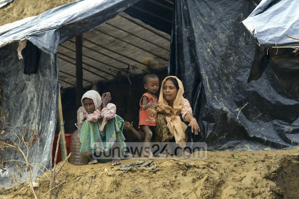 A family of Rohingya refugees at the makeshift camp on Balukhali Hill in Cox's Bazar's Ukhia. Photo: mostafigur rahman