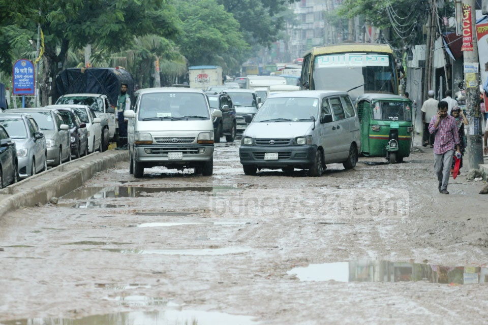 Residents of Rampura's Banasree face a horrible situation on the potholed streets. The hazards rise after rain. The photo is taken on Monday.