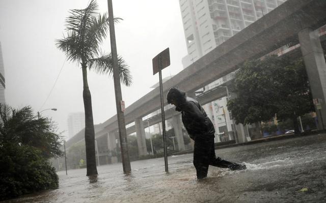 A local resident walks across a flooded street in downtown Miami as Hurricane Irma arrives at south Florida, US Sept 10, 2017. Reuters